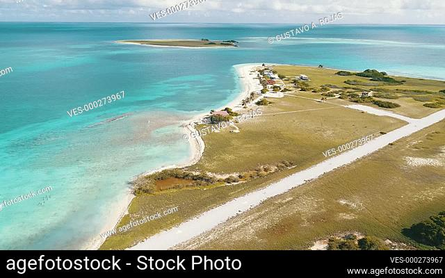 Los Roques venezuela -Caribbean sea Fantastic-aerial view landscape of BIOLOGICAL STATION and Airport in Dos mosquises island . Moving forward