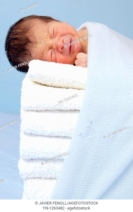 New born on soft towels