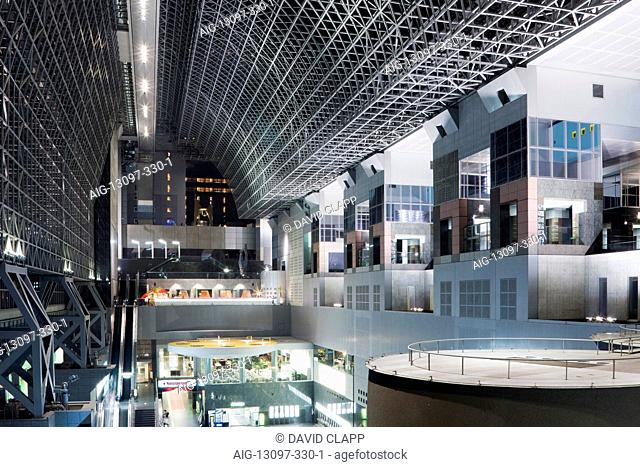 The central concourse inside the futuristic interior of Kyoto railway station, Kyoto, Japan