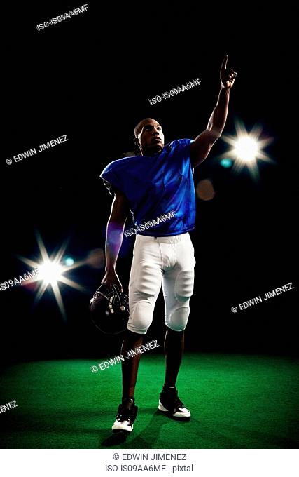 Portrait of american football player pointing finger