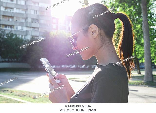 Smiling woman looking at her cell phone
