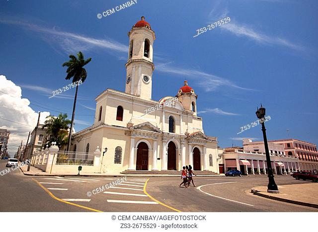 People walking in front of the Purisima Concepcion Cathedral in Jose Marti Park, Cienfuegos, Cuba, West Indies, Central America