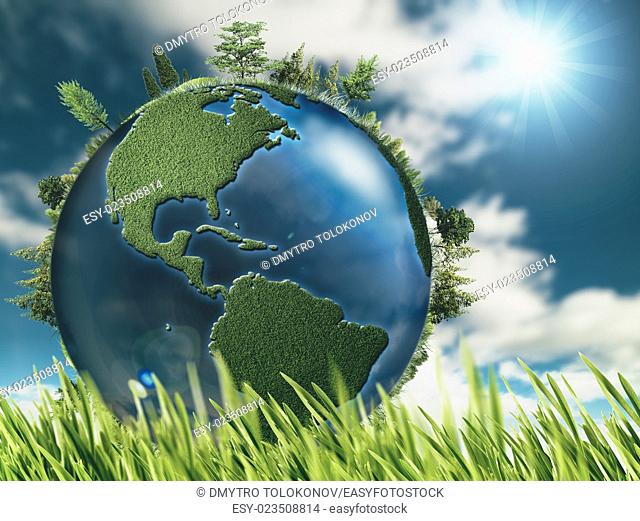 Eco natural backgrounds with Earth globe and green grass