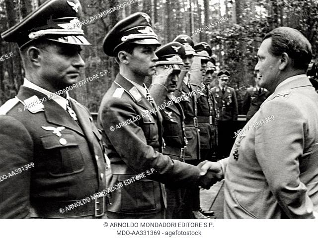 Hermann Goering shakes hands with an officer. The German Ministry of Aviation Hermann Goering, is passing in review some officers of the Luftwaffe