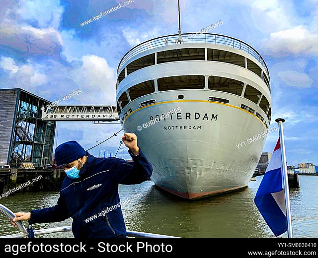 Rotterdam, Netherlands. Mooring down the Waterbus on Dock, just behind the Historical Vessel, the SS Rotterdam