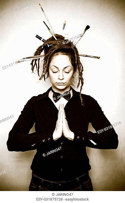 Meditating girl with dreadlocks