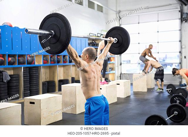 Man lifting barbell at Crossfit gym
