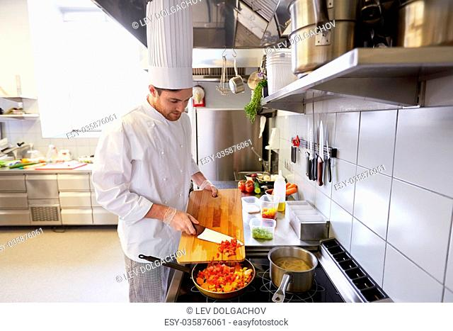 male chef cooking food at restaurant kitchen