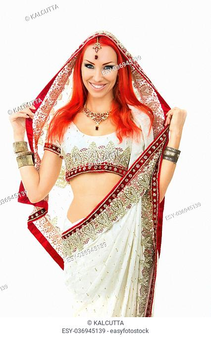 88f59e3958 Beautiful Redhead Young Sexy Woman in Traditional Indian Clothing with  Bridal Makeup and Oriental Jewelry. Beautiful Smiling Girl Bollywood dancer  ...
