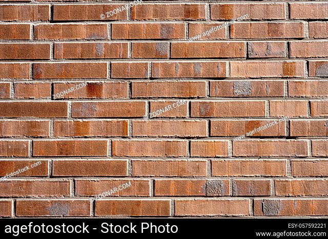 Hintergrund aus einer Wand aus braunen Backsteinen