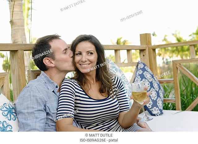Couple enjoying drinks in resort bar, Providenciales, Turks and Caicos Islands, Caribbean