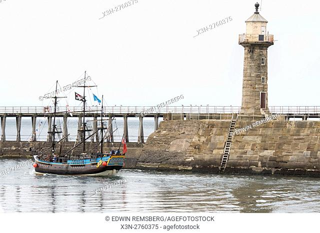 UK, England, Yorkshire - A ship setting sail out of Whitby, located on the coast of Yorkshire, England