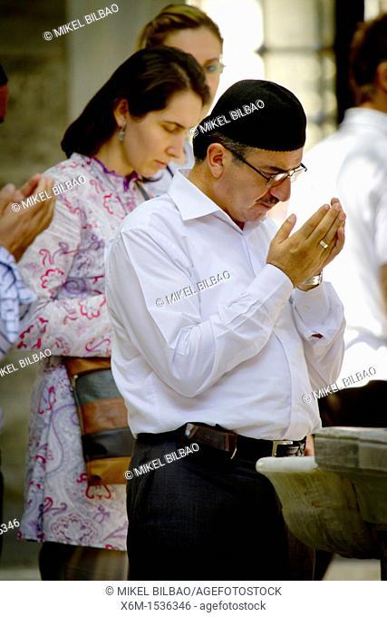 People praying in the Eyüp Sultan Mosque. Eyup, Istanbul, Turkey