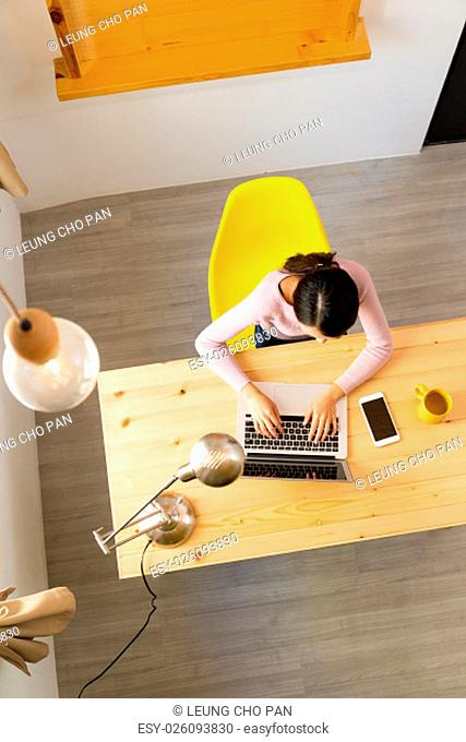 Top view of woman working at home