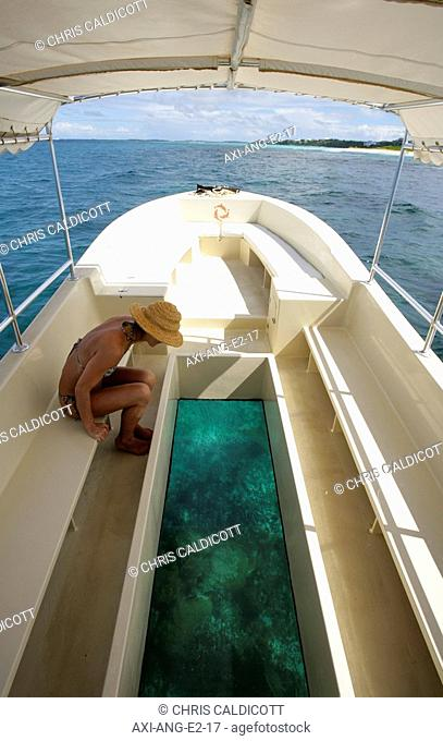 Woman on a glass bottom boat ride