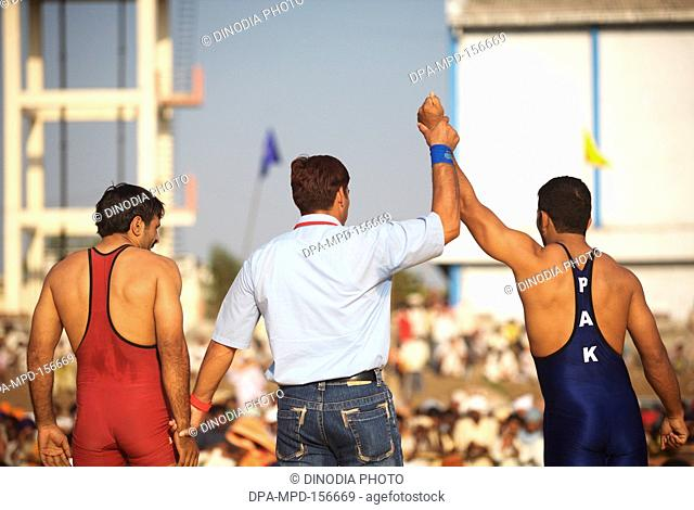 Wrestler from Pakistan declared winner during friendly wrestling match ; cultural events for 300th year's celebrations of Consecration of perpetual Sikh Guru...