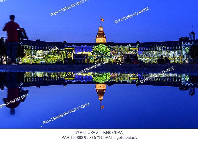 07 August 2019, Baden-Wuerttemberg, Karlsruhe: A rehearsal for the Schlosslichtspiele Karlsruhe 2019 will take place at Schloss Karlsruhe