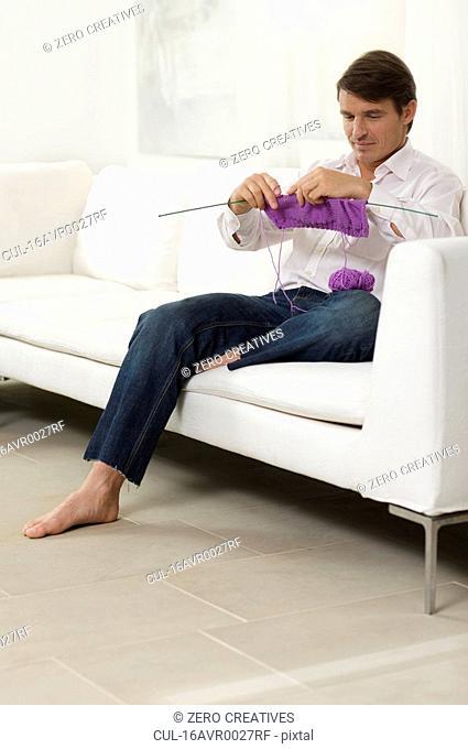 man knitting a sweater