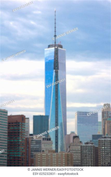 Blurred background of Freedom Tower construction in downtown Manhattan set against evening clouds