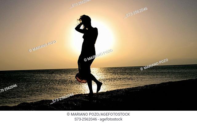 Woman in the beach during the sunset, Cabo de Gata, Almería, Andalucía, Spain, Europe