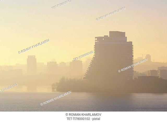 Ukraine, Dnepropetrovsk, City skyline at foggy dawn