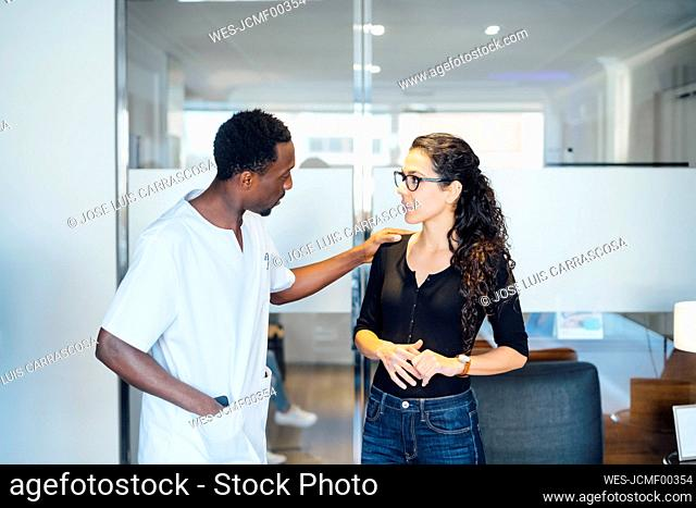Dentist with patient in dental surgery