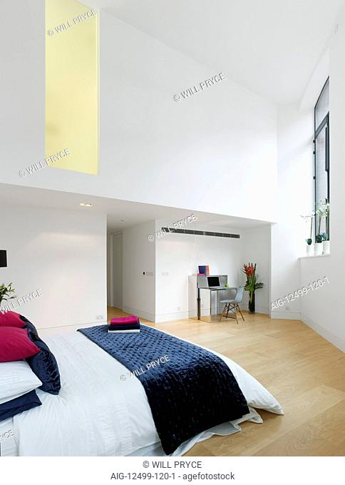 Bedroom of apartment in converted Royal Mail Sorting Office, London, UK