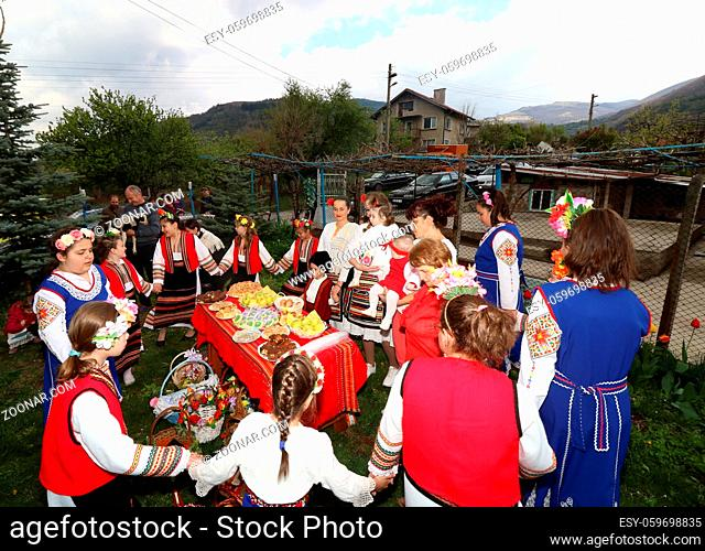 Gara Bov, Bulgaria- April 20, 2019: The girls decorate in a colorful and rich way their hairs and go around the village, singing songs and dancing
