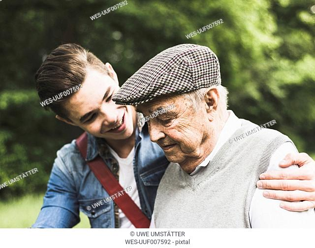 Senior man and his grandson in nature