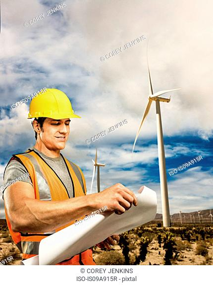 Man standing in front of wind farm