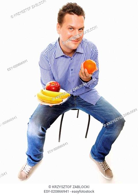 young man with fruits full length isolated