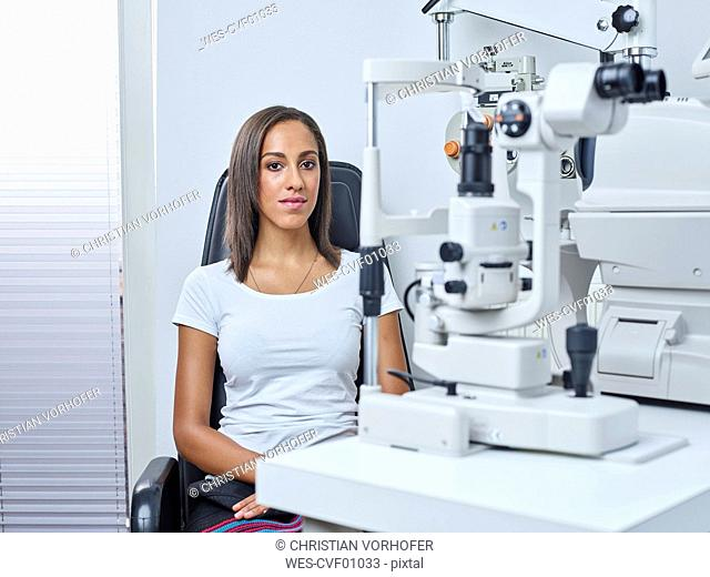 Optician, Young woman before eye test