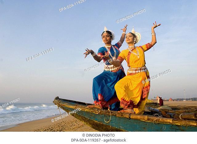 Odissi dancers performing at Chandrabhaga beach near Konarak ; Orissa ; India MR400