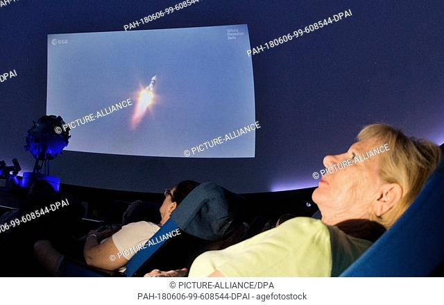 06 June 2018, Germany, Wolfsburg: Audience member Doris Albrecht following the take off of the Soyuz rocket to the International Space Station (ISS)through a...