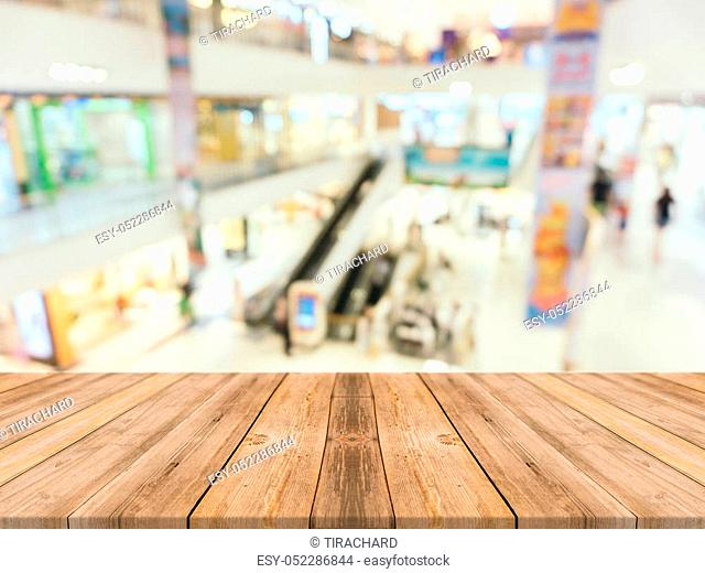 Wooden board empty table blurred background. Perspective brown wood over blur in department store - can be used for display or montage your products