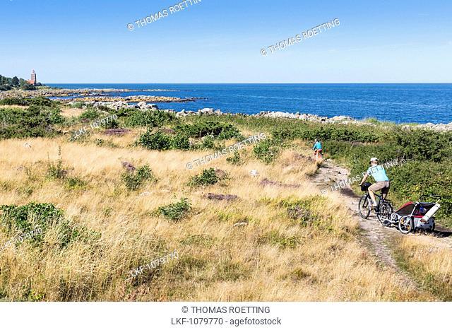 Svaneke lighthouse, rocky coast, summer, family on a cycle tour, Baltic sea, Bornholm, Svaneke, Denmark, Europe