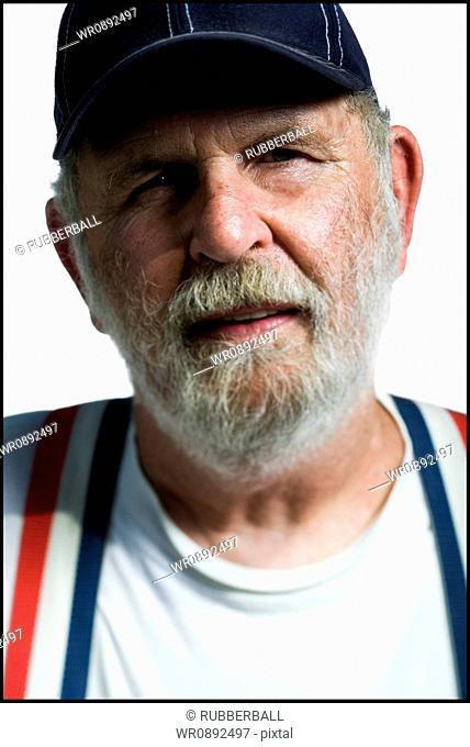 Portrait of a senior man wearing a baseball cap