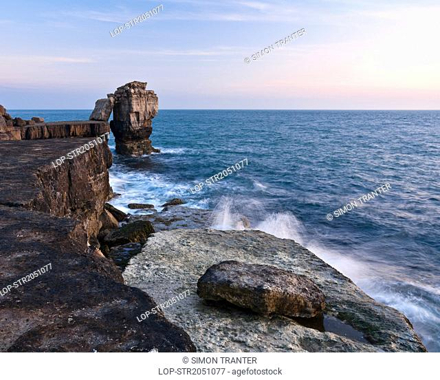 England, Dorset, Weymouth. Pulpit Rock on Portland Bill. The rock was left when quarrymen cut away a natural arch in the 1870's