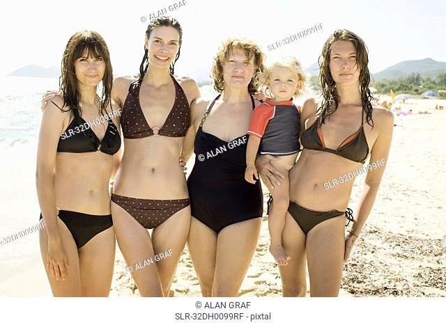 Three generations of women on beach