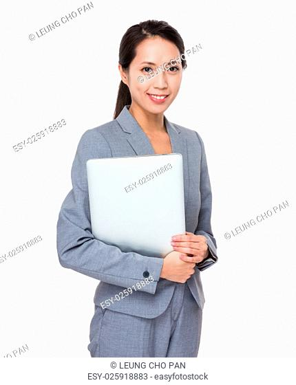 Asian Young Businesswoman hold with laptop computer
