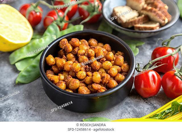 Fried chickpeas, tomatoes, mangetout, smoked tofu and lemon