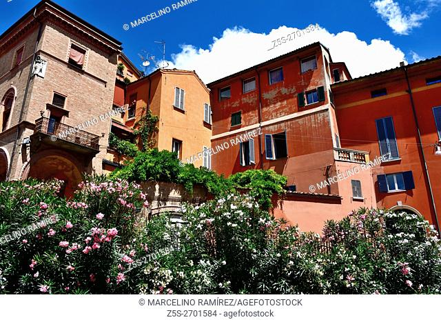 Houses painted with the characteristic reddish color of Bologna. Bologna, Emilia-Romagna, Italy, Europe