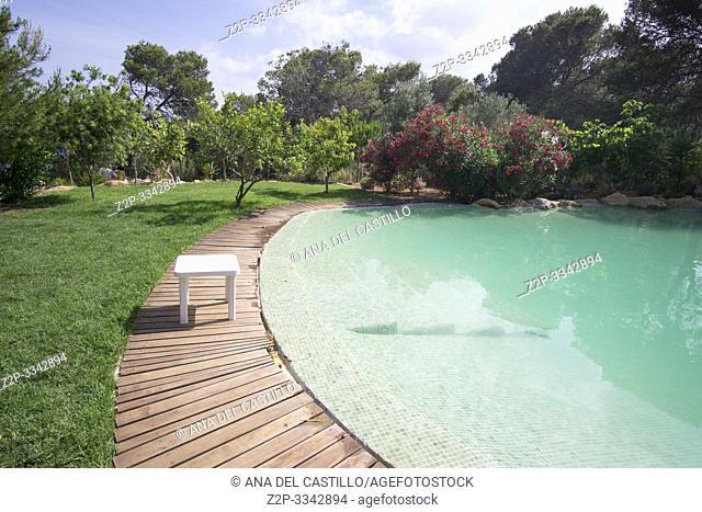 Mediterranean garden and swimming pool in Ibiza Spain