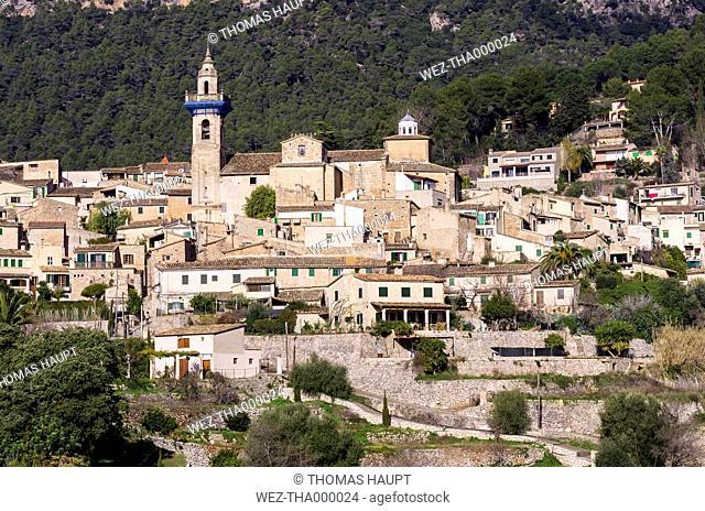 Spain, Balearic Islands, Mallorca, Valldemossa, S'Arxiduc, View to village with church
