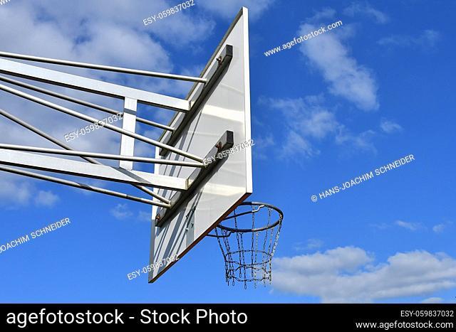 basketball, defenders hoop on a field with blue sky
