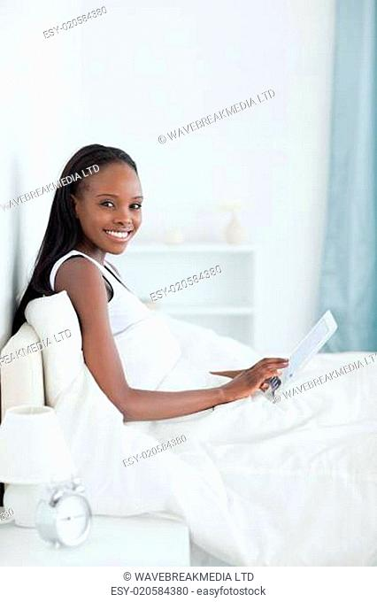 Portrait of a beautiful woman using a tablet computer