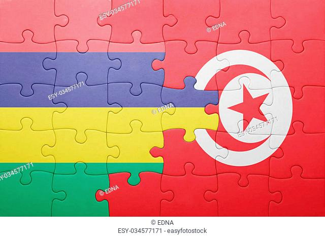 puzzle with the national flag of tunisia and mauritius . concept