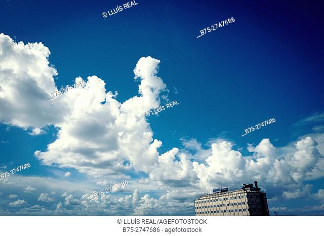Building, clouds and blue sky. Genova, Italy
