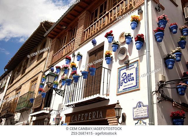 Flower pots hanging on the facade of a restaurant in Albayzin neighborhood, Albaycin, Albaicin, UNESCO World Heritage Site, Granada, Andalucia, Spain, Europe