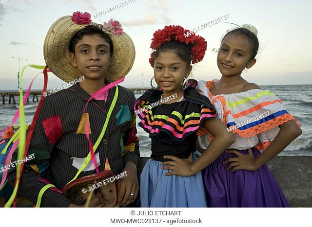 Young people with costumes at carnival parade in Granada, Nicaragua